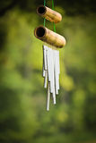 Calming Wind Chime. Photo of a wind chime with a nature background Royalty Free Stock Photo