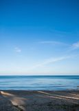 Calmly sea and clear blue sky Royalty Free Stock Image