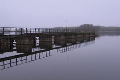 Calmness. Pier in calm water Royalty Free Stock Photography