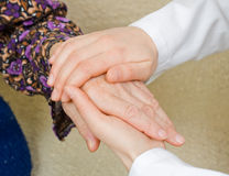 Calmness. The doctor holding an elderly woman's hand Royalty Free Stock Photos