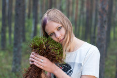 Calmness blondy girl. With moss Royalty Free Stock Photo