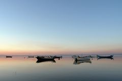 Calmness day, boats. Calmness day sunset Stock Image
