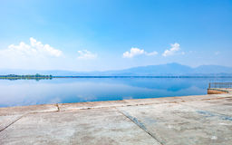 Calmness lake in the morning with mountain. And reflection in the water, Kwan Phayao or Phayao Lake Northern of Thailand Royalty Free Stock Image