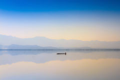 Calmness Lake in sunset Stock Photo