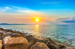 Calmness seashore with beautiful morning sunrise. Calmness rock seashore with beautiful morning sunrise Stock Photos
