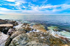 Calmness seashore with clear water and blue sky. Calmness seashore with clear water and cloudy blue sky Royalty Free Stock Image