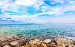 Calmness seashore with clear water and blue sky. Calmness seashore with clear water and cloudy blue sky Royalty Free Stock Photo