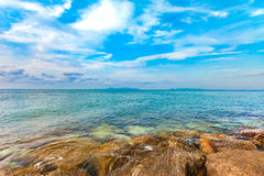 Calmness seashore with clear water and blue sky. Calmness seashore with clear water and cloudy blue sky Stock Photo