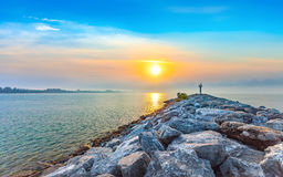 Calmness seashore in morning sunrise with warning tower. At Rayong Province Eastern of Thailand Stock Photo