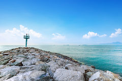 Calmness seashore with warning tower and bright blue sky. At Rayong Province Eastern of Thailand Royalty Free Stock Image