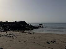 Calmy strand i ett avslappnande ställe Arkivbild