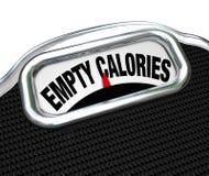 Calorías vacías de escala de la palabra alimenticia contra la consumición de los alimentos de preparación rápida Foto de archivo
