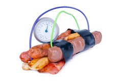 Calorie Bomb. Composition of fat foods arranged as a time bomb with timer and cables. Metaphor Stock Image