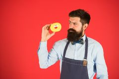 Calorie. Chef feel hunger. Calorie counting. Diet and healthy food. gain calorie. Bearded man in chef apron. Chef man in. Cafe. Food calorie. baker hold donut royalty free stock photo