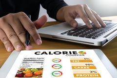 Calorie counting counter application medical eating healthy die Stock Image