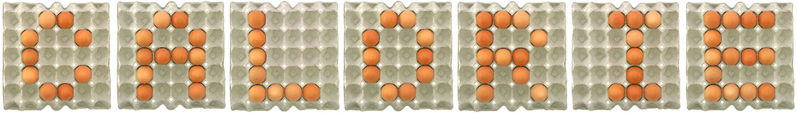 CALORIE word from eggs in paper tray Royalty Free Stock Photo
