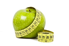 Calories. Apple and measuring tape  on white background Stock Photo