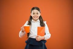Calories fuel for brain. Inspiring drink. Girl drink cocoa or tea. Schoolgirl with mug having tea break. Relax and. Recharge. Water balance. Enjoying tea before stock photo