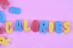 Calories word on pink table Royalty Free Stock Image