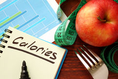 Calories written in a diary. Calorie counting concept royalty free stock image