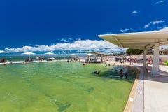 CALOUNDRA, AUS - DEC 06 2015: Hot sunny day at swimming pool, Ki Royalty Free Stock Photos
