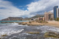 Calp Spain view of beach waves and seafront hotels and apartments. On the Spanish Mediterranean coast royalty free stock images