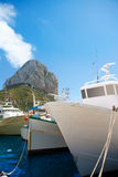 Calpe Alicante fisherboats with Penon de Ifach. In Mediterranean Spain Royalty Free Stock Images