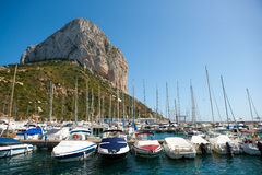 Calpe Alicante marina boats with Penon de Ifach. Mountain in Mediterranean sea of Spain Stock Photos