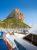 Calpe Alicante marina boats with Penon de Ifach. Mountain in Mediterranean sea of Spain Stock Image