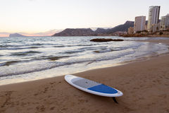 Calpe Alicante sunset at beach Cantal Roig. In Mediterranean Spain with paddle sufboard Stock Photography