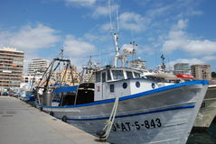 Calpe fish dock. Calpe fishing port with the typical high buildings at the back Royalty Free Stock Photos