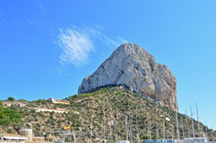 Calpe Rock With A Blue Sky Background. The giant boulder that overlooks Calpe in Spain Stock Photos