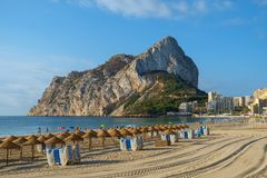 Calpe Rock, Ifach, and Calpe town seen from one of the beaches north of the town, Costa Blanca, Spain. Stock Photo