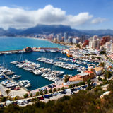 Calpe. Spain. Panorama of the marina with yachts on the background the city and hills. Selective focus. High angle view Royalty Free Stock Image