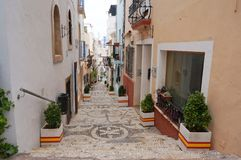 Calpe streets. View to an old street of Calpe, Alicante, Spain nicely decorated Stock Photography
