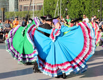 Calpulli Mexican Dance Company. Dancers of the Calpulli Mexican Dance Company,dressed with traditional Mexican colorful clothes.They perform traditional regional Royalty Free Stock Photos