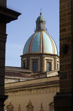The ceramic decorated dome of the San Giuliano cathedral in Caltagirone. Cupola of Caltagirone cathedral viewed from between buildings, Sicily stock photo