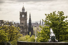 The Calton Hill cannon. Picture of the Calton Hill cannon with Edinburgh landmarks in the background (Scott Monument, The Balmoral Stock Photos