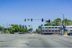 Caltrain crossing at a street junction near a residential neighborhood in Sunnyvale. August 30, 2017 Sunnyvale/CA/USA - Caltrain crossing at a street junction Royalty Free Stock Images