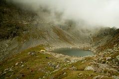 Caltun Lake near Negoiu Peak, Carpathians Mountains, Romania Stock Photos