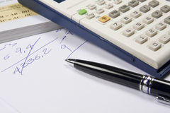 Calulator and a pen Royalty Free Stock Image