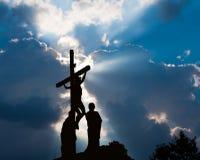 Calvary. Crucifixion of Jesus Christ with dramatic sky Stock Photos