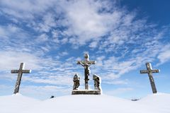 Three cross covered with snow - Calvary royalty free stock images