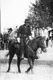 Calvary captain riding on horse Stock Image