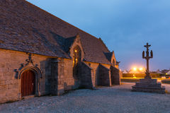 Calvary and chapel. De la joie at night in Brittany, France Royalty Free Stock Photos