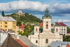 Calvary and Church of the assumption in Banska Stiavnica, Slovak. Republic. Sunset urban scene. Travel destination stock image