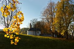 Calvary in Slovakia. Christian church in Banska Bystrica. Falling leafs in autumn landscape, Catholic chapel with cross symbol Stock Photography