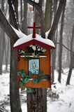 Calvary in the woods. Look at the wayside in a snowy forest Stock Images