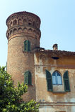Calvenzano (Italy), ancient building. Calvenzano (Bergamo, Lombardy, Italy), ancient building with cylindrical tower under a blue sky stock photos