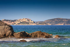 Calvi citadel taken from Plage de Petra Muna, Corsica Royalty Free Stock Photo